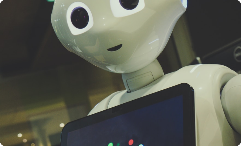 A friendly robot displays its built-in touchscreen, another innovation that represents the evolving future of data center technology and management.